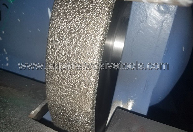application of New Type Vacuum Brazed Technology in Cast Iron Grinding -Active Brazing