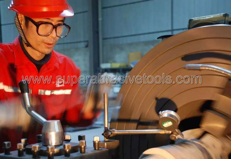 PDC drill bit truing with diamond grinding wheels